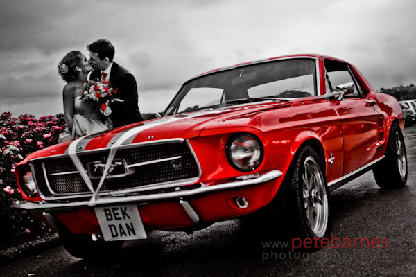 Bride-and-Groom-kissing-after-the-wedding-with-a-classic-red-ford-mustang-car-IMG_6044-2-Edit1.jpg